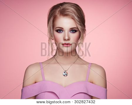 Portrait Beautiful Blonde Woman With Jewelry. Model Girl In Elegant Pink Dress. Magnificent Hairstyl