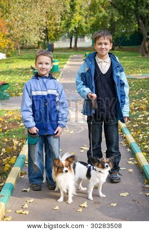 Two Boys With Dogs