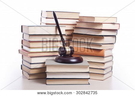 Law Concept. Books With Wooden Judges Gavel On Table In A Courtroom Or Enforcement Office.