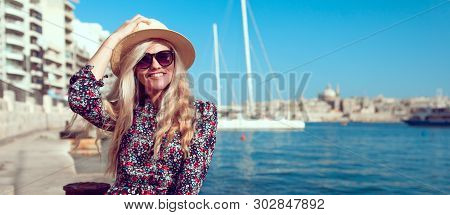 Happy Young Tourist Woman In Hat Toothy Smile With Mediterranean Panorama