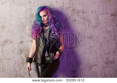 Daring Rebel Rocker, In Black Leather Clothes With Colored Hair. Young Stylish Woman With Trendy Gra