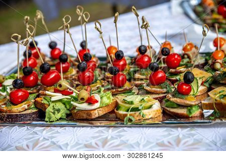 Beautifully Decorated Catering Banquet Table For Wedding. Catering Service Buffet Plate With Canapes