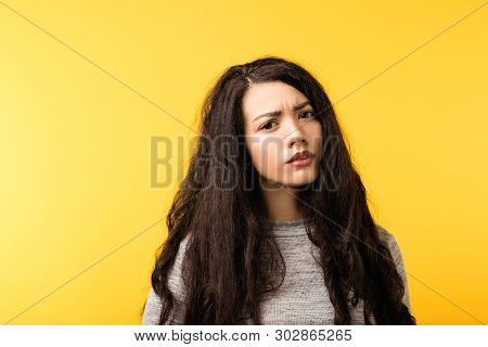 Portrait Of Mistrustful Emotional Brunette Girl With Concerned, Disappointed Facial Expression. Copy