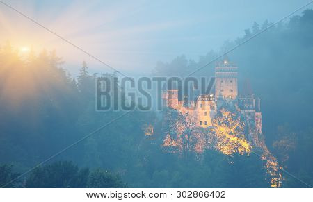 Misty Morning View Of Bran Castle Known For The Myth Of Dracula. Bran Or Dracula Castle In Transylva