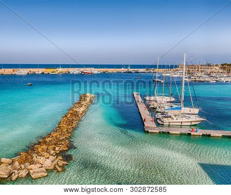 Several Fishing Boats At The Otranto Harbour - Coastal Town In Puglia With Turquoise Sea. Italian Va