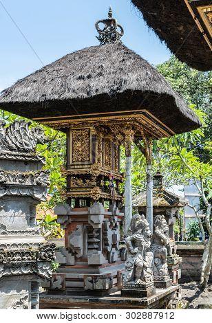 Dusun Ambengan, Bali, Indonesia - February 25, 2019: Decorated Gray Stone Memorial Pillar At Family