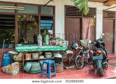 Dusun Ambengan, Bali, Indonesia - February 25, 2019: Family Compound. Green Covered Work Table With