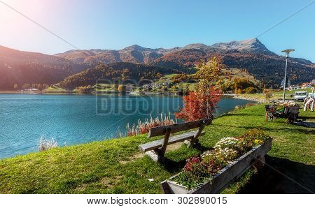 Impressive View Of Resia Village With Perfect Sky. Impressively Beautiful Autumn Of Italian Alps And