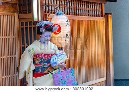Kyoto, Japan - Dec 12 2018 : Geisha Wearing Traditional Dress (kimono) Leaving A Tea House. Geisha A