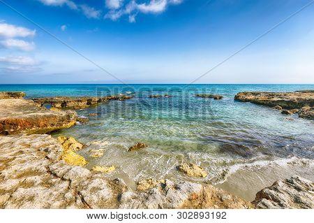 Picturesque Seascape With White Rocky Cliffs, Sea Bay, Islets And Faraglioni Near By Conca Specchiul