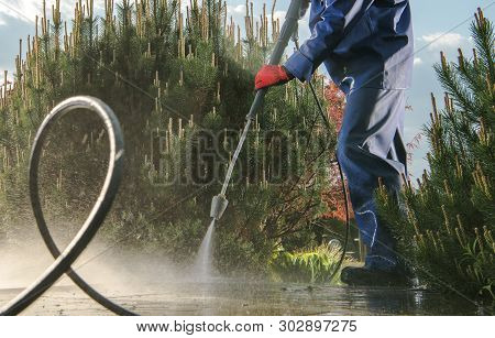 Garden Paths Power Washing Using Pressure Washer. Backyard Maintenance.