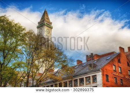 The Custom House Clock Tower In The City Of Boston Massachusetts Cityscape On A Cloudy Blue Sky Day.