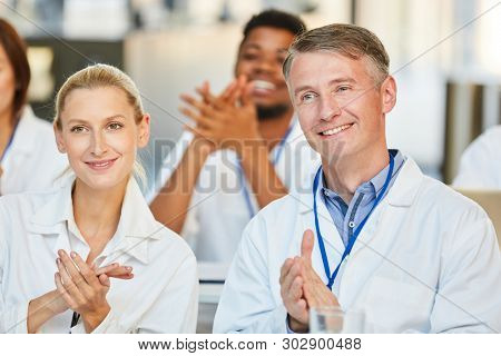 Doctors audience claps applause after a seminar for further education or training