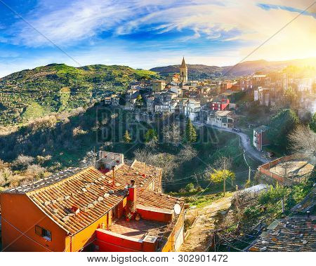 Panorama Of The Belltower And The Village In The Valley At Sunrise. Mountain Village Novara Di Sicil