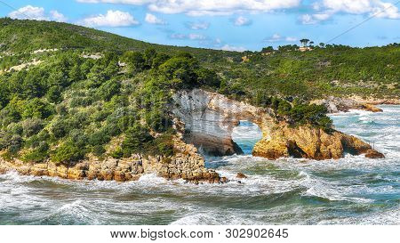Gargano Coast: San Felice Arch (architello). Vieste, San Felice Arch Rock Bay, Gargano Peninsula, Ap