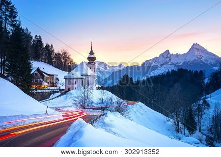 Beautiful Winter Wonderland Mountain Scenery In The Alps With Pilgrimage Church Of Maria Gern And Fa