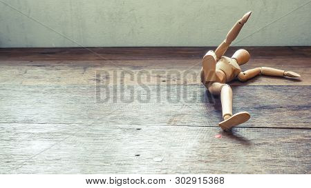 Wooden Mannequin Falling Down. Fall Concept. Business. Life. Failure Idea Background