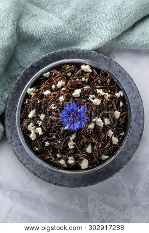 Wild Black Rice With A Lactose-free Feta Cheese And An Edible Flower, A Blue Cornflower, Shot From A