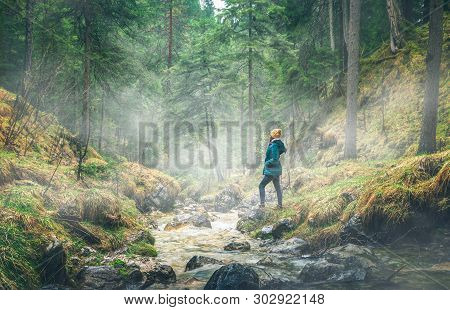 Girl Walking Through Forest On A Rainy Day. River In Forest Nature. Green Forest With Fog. Nature. R