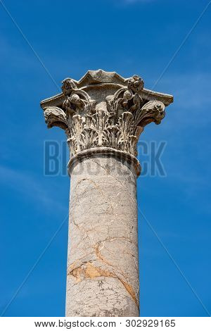 Column with capital in Corinthian style in Ostia Antica, Roman colony founded in the 7th century BC. Rome, UNESCO world heritage site, Italy, Latium, Europe poster