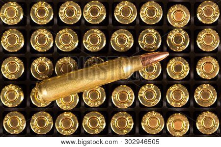 Ammunition Cartridge On Background. Golden Bullet Close Up.