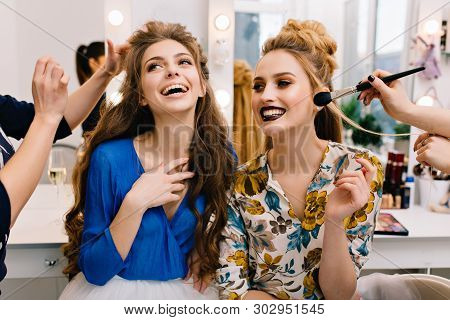 Preparation to great party of joyful young women in hairdresser salon. Expressing true positive emotions, stylish look, fashionable models, beautiful coiffure, makeup, beauty service, stylist. poster