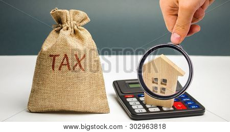 A bag with the word Tax and calculator with a house. Taxes on real estate, payment. Penalty, arrears. Register of taxpayers for property. Law-abiding, evasion of payment. Court law. Luxury tax poster