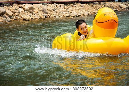 Boy Enjoy And Has Fun Rowing Downstream On Canal