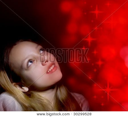 Girl looking at red stars light