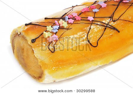 brazo de gitano, typical spanish swiss roll filled with pastry cream