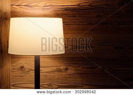 Floor Lamp Against Wooden Wall. Torfhaus, Germany