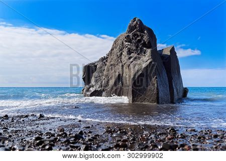 Close-up Of Rock Formation At The Coastline Against Blue Sky. Praia Formosa Beach In Funchal On Port