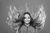 Strong and healthy hair concept. How to treat curly hair. Nice and tidy hairstyle. Easy tips making hairstyle for kids. Small child long hair. Charming beauty. Girl active kid with long gorgeous hair. poster