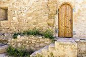 Door in a garden of the Borj el Kebir Castle in Houmt El Souk in Djerba, Tunisia poster