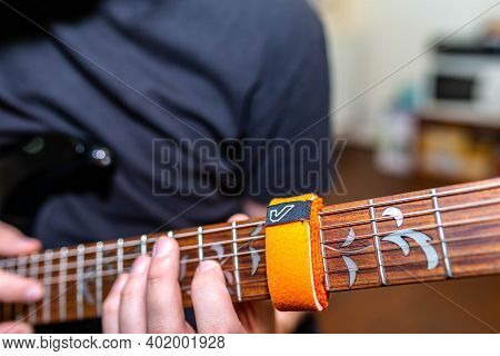 Miercurea Ciuc, Romania- 05 January 2021: Young Musician Playing On Ibanez Guitar Using A Gruvgear F