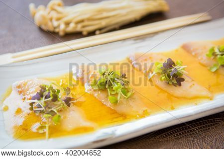 Pieces Of White Tuna With Herbs And Sauce