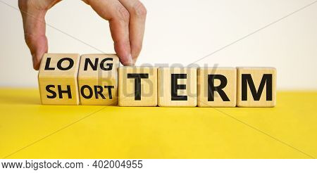 Long Or Short Term Symbol. Hand Turns Cubes And Changes Words 'short Term' To 'long Term'. Beautiful