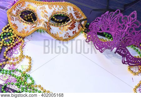Mardi Gras Mask And Beads Frame For Text On White Space Background. Madi Gras Celebration Fat Tuesda