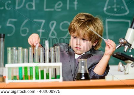 Wunderkind Experimenting With Chemistry. Boy Test Tubes Liquids Chemistry. Chemical Analysis. Talent