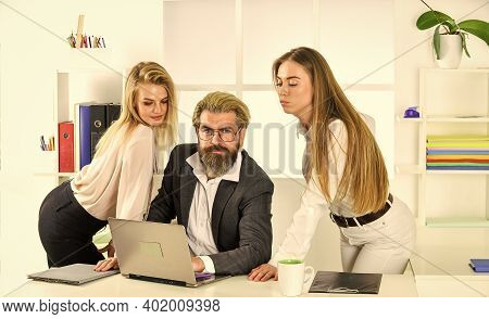 Analyzing Sales. Office People Discuss Business. Modern Office Life. Accountant Or Secretary At Work