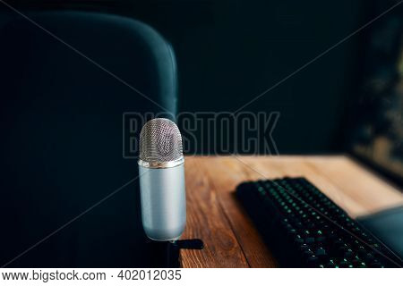 Radio Show Or Audio Podcast Concept. Mic With Keyboard In Radio Or Podcast Studio With Computer Set