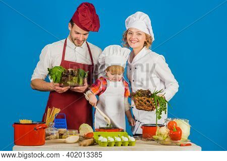 Family Cooking Together. Family Relationships. Healthy Food At Home. Healthy Lifestyle. Advertising.