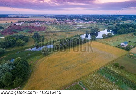 Summer Rural Landscape, Aerial View. View Of Village, Arable Fields And River