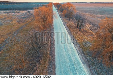 Aerial View Of The Countryside. Direct Country Road And Arable Fields In The Autumn Evening