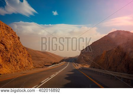 Driving A Car On A Mountain Road. Desert Landscape. The Road From Arad To The Dead Sea. View From Th