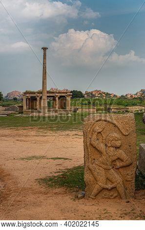 Hampi, Karnataka, India - November 4, 2013: Hazara Rama Temple. Landscape With Flag Post Ans Ruinous