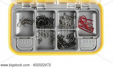 Opened Tackle Box With Fishing Hooks And Accessories. Fishing Hooks In Box Sections. Case For Tackle