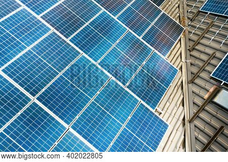 Closeup Of A Private House With Solar Photovoltaic Panels For Producing Clean Electricity On Roof. A