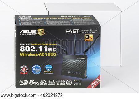 Brnenec, Czech Republic - January 31, 2020: Paper Box, Inside Wifi Router Asus Rt-ac68u, Wireless De