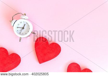 Time For Love - Alarm Clock And Hearts On Pink Background.love Heart With Time Clock. Time To Stay A